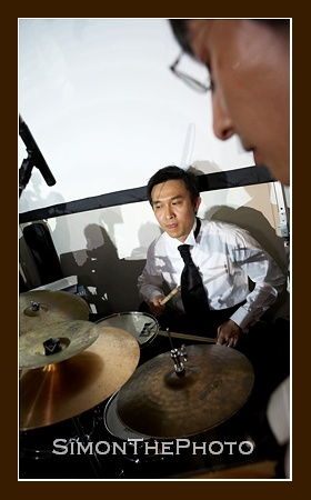 Jimmy was play drum with his music teacher